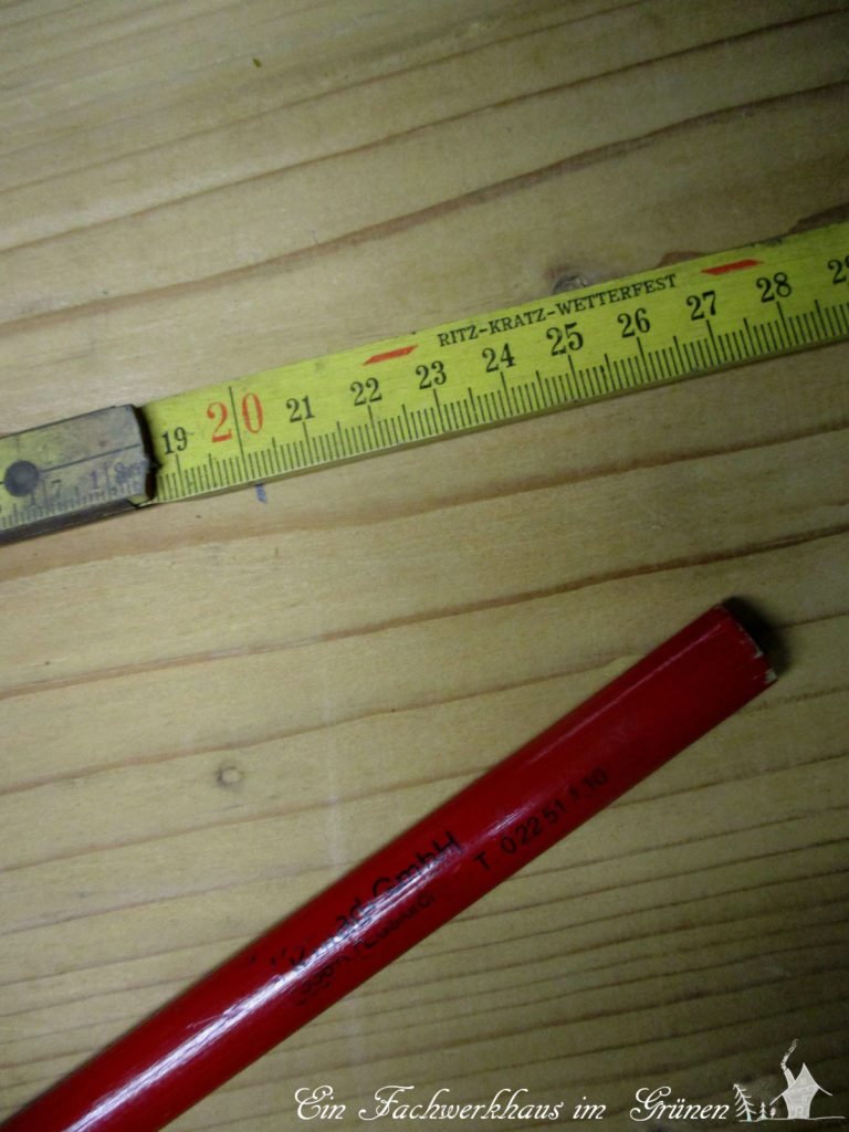 Zollstock und Stift