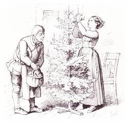Ein Weihnachtsbaum wird geschmückt.